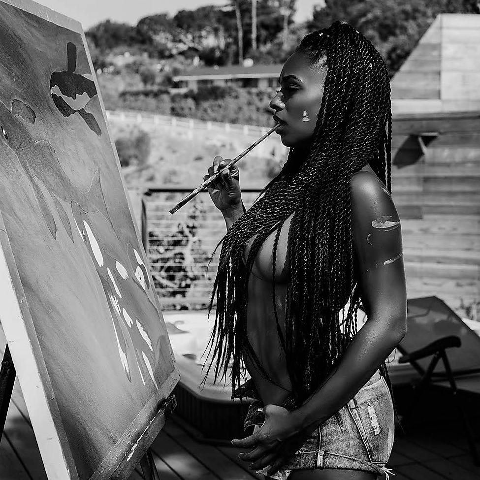 Melyssa Ford painting while topless