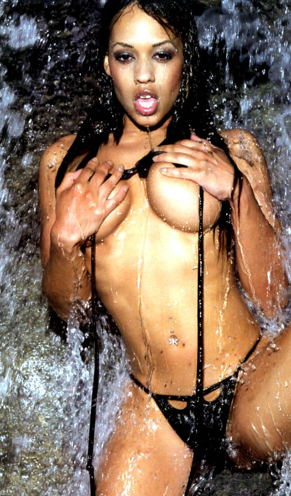 Melyssa Ford taking off her top in the water