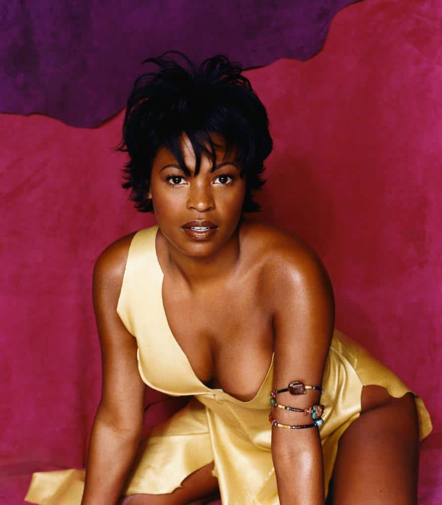Nia Long cleavage in gold dress