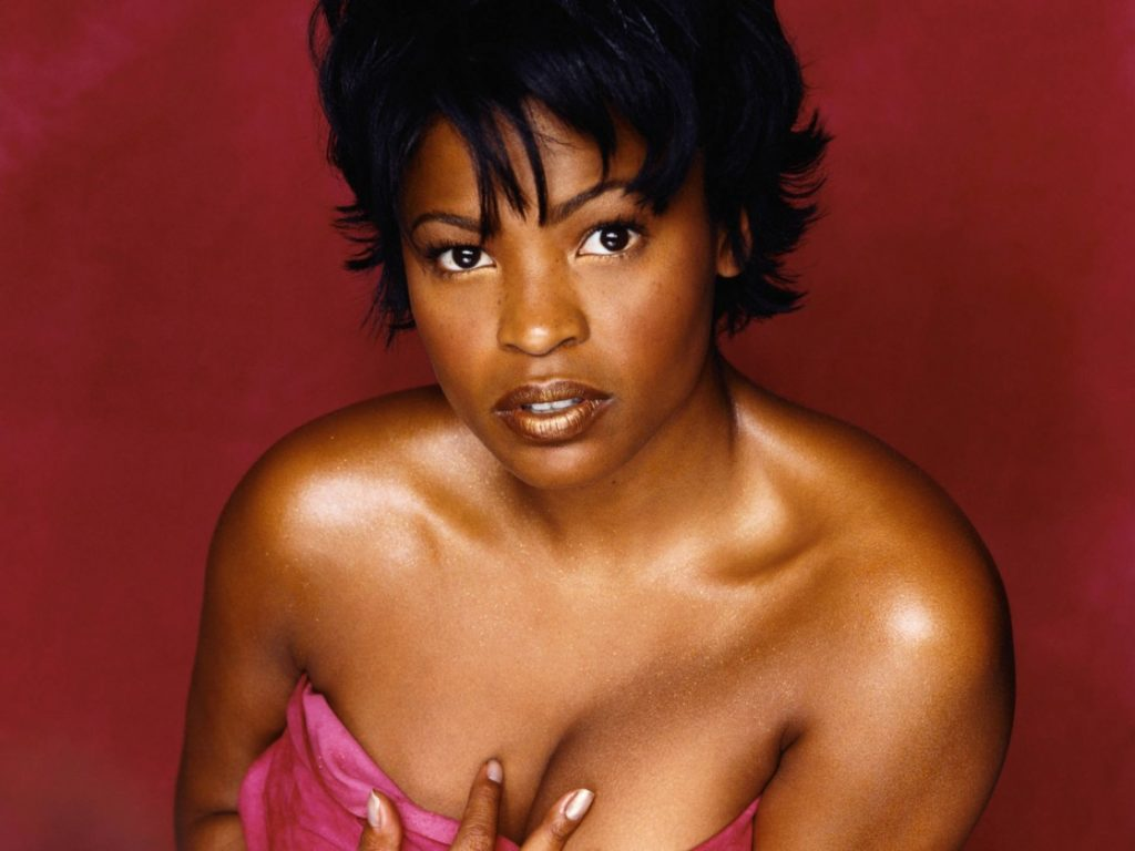 Nia Long modeling with cleavage exposed