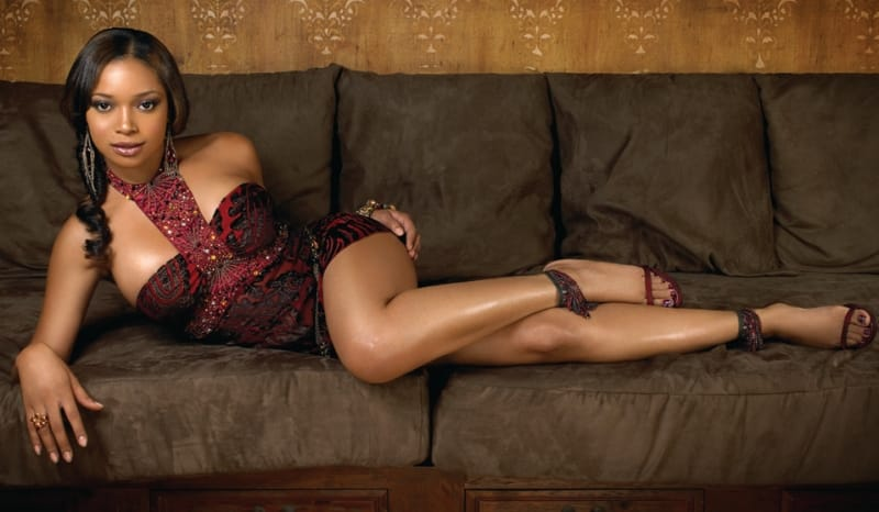 Tamala Jones modeling on couch