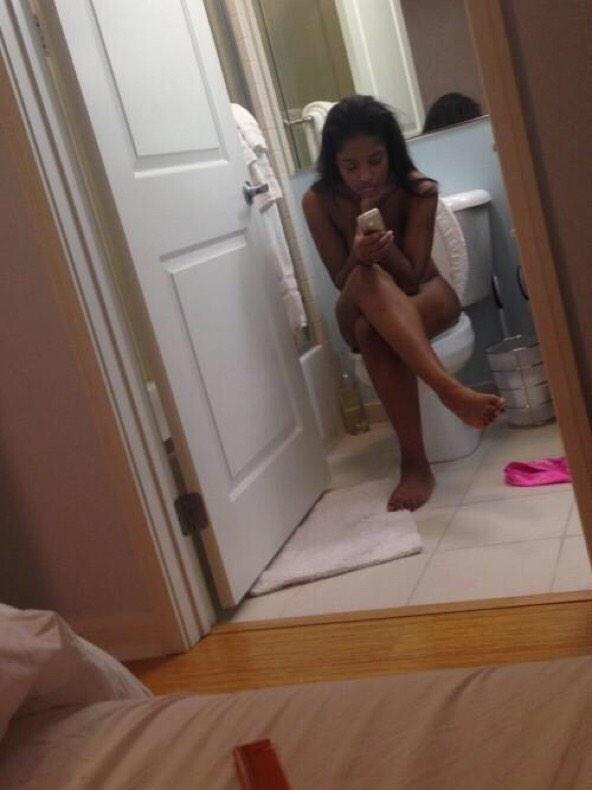 Keke sitting on a toilet nude