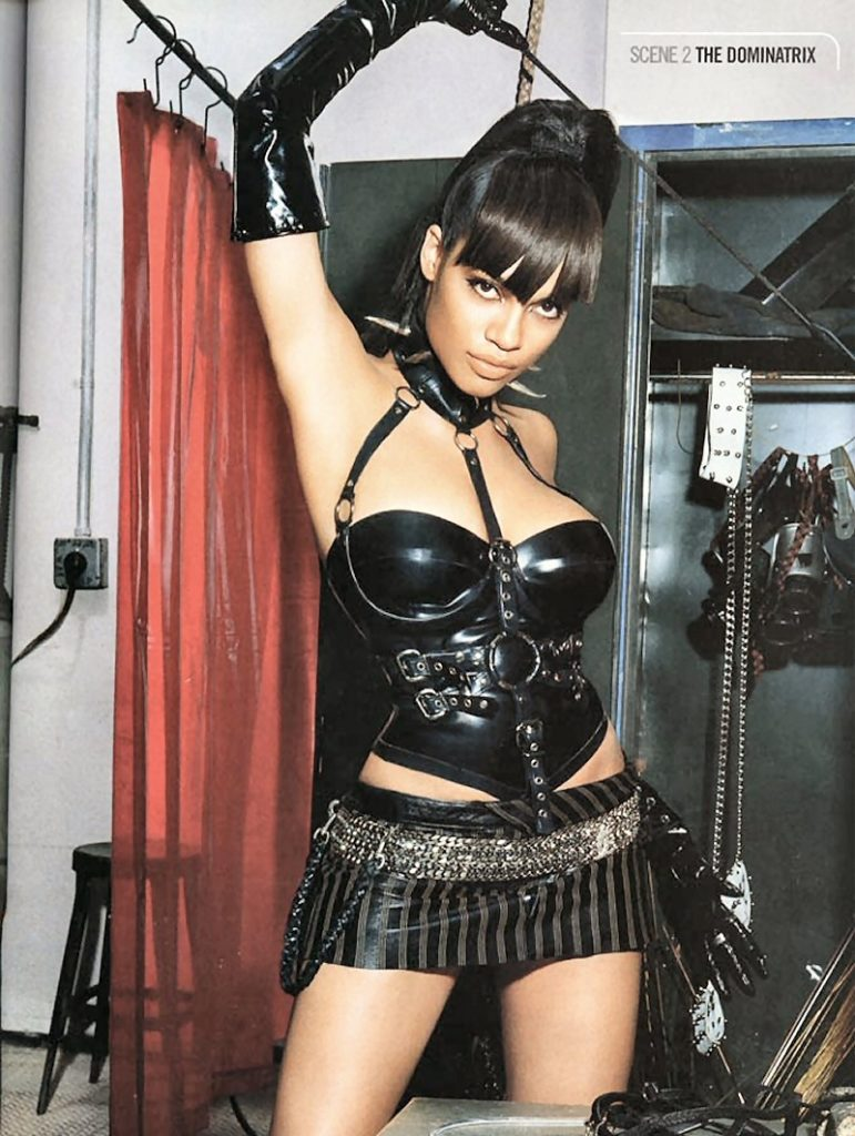 Rosario Dawson in leather shorts and a corset