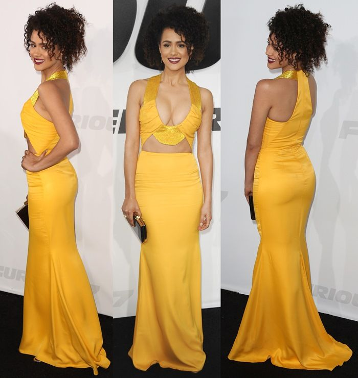 Nathalie Emmanuel in a yellow gown looking radiant