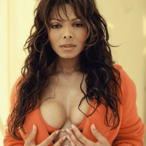 Janet Jackson in red top squeezing her breasts