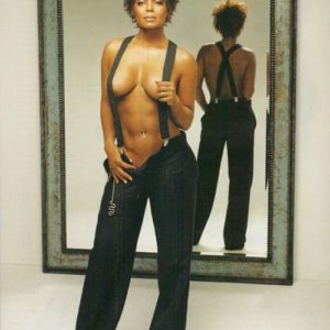 Janet Jackson with no shirt in suspenders